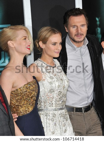 """LOS ANGELES, CA - FEBRUARY 16, 2011: Liam Neeson with January Jones (left) & Diane Kruger at the premiere of """"Unknown"""" at the Mann Village Theatre, Westwood. February 16, 2011  Los Angeles, CA - stock photo"""