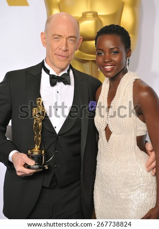 LOS ANGELES, CA - FEBRUARY 22, 2015: Lupita Nyongo & J.K. Simmons at the 87th Annual Academy Awards at the Dolby Theatre, Hollywood.  - stock photo