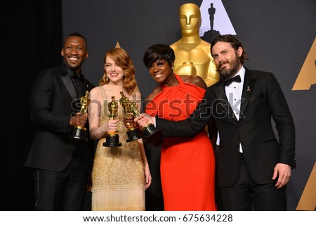 LOS ANGELES, CA - FEBRUARY 26, 2017: Mahershala Ali, Emma Stone, Viola Davis & Casey Affleck in the photo room at the 89th Annual Academy Awards at Dolby Theatre, Los Angeles