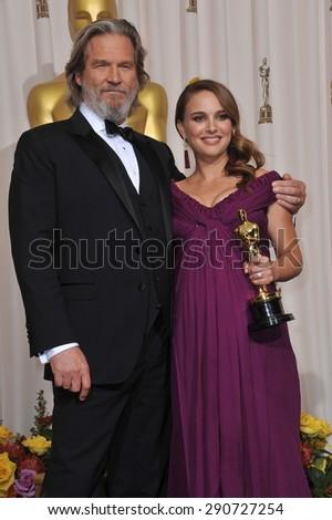 LOS ANGELES, CA - FEBRUARY 27, 2011: Natalie Portman & Jeff Bridges at the 83rd Academy Awards at the Kodak Theatre, Hollywood. - stock photo