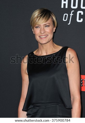 """LOS ANGELES, CA - FEBRUARY 13, 2014: Robin Wright at the season two premiere of her Netflix series """"House of Cards"""" at the Directors Guild Theatre. - stock photo"""