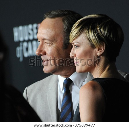 "LOS ANGELES, CA - FEBRUARY 13, 2014: Robin Wright & Kevin Spacey at the season two premiere of their Netflix series ""House of Cards"" at the Directors Guild Theatre."