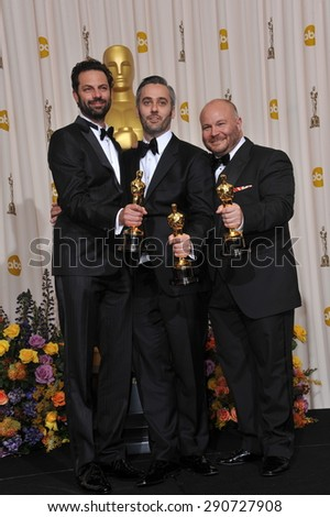 LOS ANGELES, CA - FEBRUARY 27, 2011: The King's Speech producers Iain Canning & Emile Sherman & Gareth Unwin at the 83rd Academy Awards at the Kodak Theatre, Hollywood.