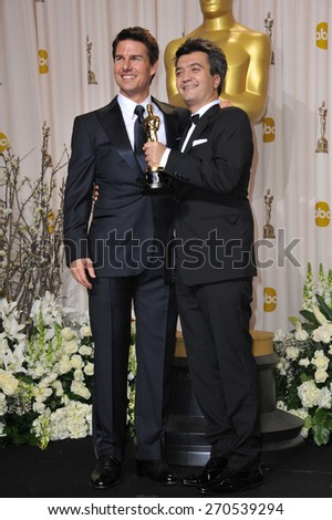 LOS ANGELES, CA - FEBRUARY 26, 2012: Tom Cruise & The Artist producer Thomas Langmann at the 82nd Academy Awards at the Hollywood & Highland Theatre, Hollywood.