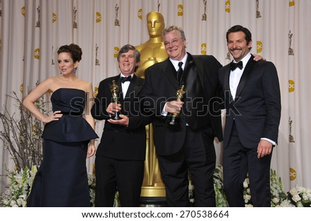 LOS ANGELES, CA - FEBRUARY 26, 2012: Tom Fleischman & John Midgley, winners for Best Sound Mixing for Hugo, with Tina Fey & Bradley Cooper at the 82nd Academy Awards in Hollywood.  - stock photo