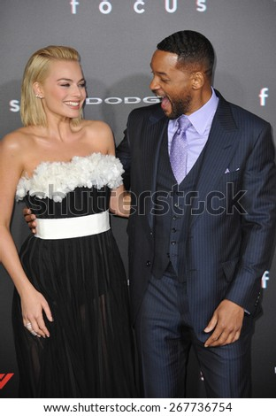 "LOS ANGELES, CA - FEBRUARY 24, 2015: Will Smith & Margot Robbie at the Los Angeles premiere of their movie ""Focus"" at the TCL Chinese Theatre, Hollywood.  - stock photo"