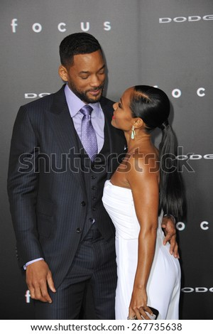 "LOS ANGELES, CA - FEBRUARY 24, 2015: Will Smith & wife Jada Pinkett Smith at the Los Angeles premiere of his movie ""Focus"" at the TCL Chinese Theatre, Hollywood.  - stock photo"