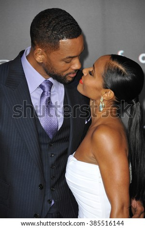 """LOS ANGELES, CA - FEBRUARY 24, 2015: Will Smith & wife Jada Pinkett Smith at the Los Angeles premiere of his movie """"Focus"""" at the TCL Chinese Theatre, Hollywood. - stock photo"""