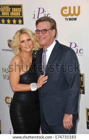 LOS ANGELES, CA - JANUARY 16, 2014: Aaron Sorkin & Carrie Keagan at the 19th Annual Critics' Choice Awards at The Barker Hangar, Santa Monica Airport.
