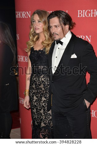 LOS ANGELES, CA - JANUARY 2, 2016: Actor Johnny Depp & actress wife Amber Heard at the 2016 Palm Springs International Film Festival Awards Gala - stock photo