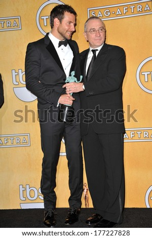 LOS ANGELES, CA - JANUARY 18, 2014: Bradley Cooper & Robert De Niro at the 20th Annual Screen Actors Guild Awards at the Shrine Auditorium.  - stock photo