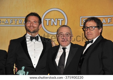LOS ANGELES, CA - JANUARY 18, 2014: Bradley Cooper, Robert De Niro & director David O. Russell at the 20th Annual Screen Actors Guild Awards at the Shrine Auditorium.
