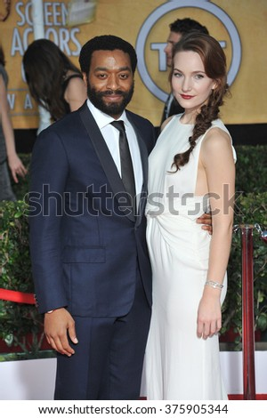 LOS ANGELES, CA - JANUARY 18, 2014: Chiwetel Ejiofor & Sari Mercer at the 20th Annual Screen Actors Guild Awards at the Shrine Auditorium. - stock photo