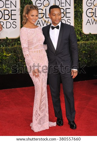 LOS ANGELES, CA - JANUARY 11, 2015: Chrissy Teigen & John Legend at the 72nd Annual Golden Globe Awards at the Beverly Hilton Hotel, Beverly Hills. - stock photo