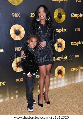 "LOS ANGELES, CA - JANUARY 6, 2015: Genis Wooten & mother Jennia Fredrique at the premiere of Fox's new TV series ""Empire"" at the Cinerama Dome, Hollywood.  - stock photo"