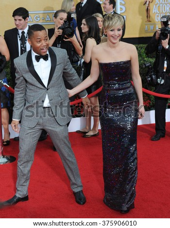 LOS ANGELES, CA - JANUARY 18, 2014: Jennifer Lawrence & Cuba Gooding Jr. at the 20th Annual Screen Actors Guild Awards at the Shrine Auditorium. - stock photo