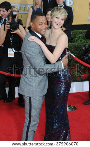 LOS ANGELES, CA - JANUARY 18, 2014: Jennifer Lawrence & Cuba Gooding Jr. at the 20th Annual Screen Actors Guild Awards at the Shrine Auditorium.