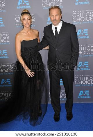 LOS ANGELES, CA - JANUARY 15, 2015: Kevin Costner & wife Christine Baumgartner at the 20th Annual Critics' Choice Movie Awards at the Hollywood Palladium.  - stock photo