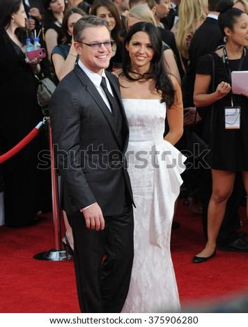 LOS ANGELES, CA - JANUARY 18, 2014: Matt Damon & wife Luciana Barroso at the 20th Annual Screen Actors Guild Awards at the Shrine Auditorium. - stock photo