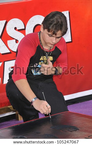 LOS ANGELES, CA - JANUARY 26, 2012: Michael Jackson's son Prince Michael Jackson placing his father's glove & shoe-prints in cement at the Chinese Theatre. January 26, 2012  Los Angeles, CA