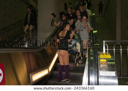 "Los Angeles, CA - January 11, 2015: People without pants down the stairs in the 7th Annual International ""No Pants Metro Ride"""