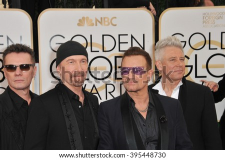 LOS ANGELES, CA - JANUARY 12, 2014: U2 with Bono & The Edge at the 71st Annual Golden Globe Awards at the Beverly Hilton Hotel. - stock photo