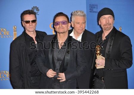 LOS ANGELES, CA - JANUARY 12, 2014: U2 with Bono & The Edge in the press room at the 71st Annual Golden Globe Awards - stock photo