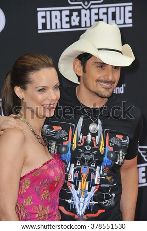 """LOS ANGELES, CA - JULY 15, 2014: Brad Paisley & wife Kimberly Williams-Paisley at the world premiere of Disney's """"Planes: Fire & Rescue"""" at the El Capitan Theatre, Hollywood. - stock photo"""