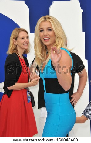 """LOS ANGELES, CA - JULY 28, 2013: Britney Spears at the Los Angeles premiere of her movie """"The Smurfs 2"""" at the Regency Village Theatre, Westwood.  - stock photo"""