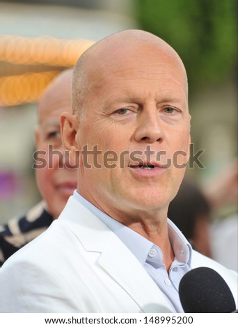"""LOS ANGELES, CA - JULY 11, 2013: Bruce Willis at the Los Angeles premiere of his new movie """"Red 2"""" at the Westwood Village Theatre.  - stock photo"""