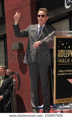 LOS ANGELES, CA - JULY 16, 2013: Bryan Cranston presented with the 2,502nd star on the Hollywood Walk of Fame.