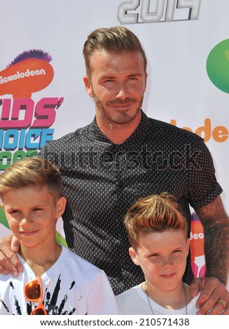 LOS ANGELES, CA - JULY 17, 2014: David Beckham & sons Romeo & Cruz at the first annual Nickelodeon Kids Choice Sports Awards at Pauley Pavilion, UCLA.  - stock photo