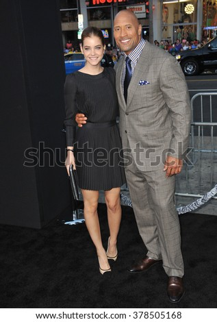 """LOS ANGELES, CA - JULY 23, 2014: Dwayne Johnson & Barbara Palvin at the premiere of their movie  """"Hercules"""" at the TCL Chinese Theatre, Hollywood. - stock photo"""