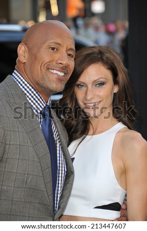 "LOS ANGELES, CA - JULY 23, 2014: Dwayne Johnson & girlfriend Lauren Hashian at the premiere of his movie  ""Hercules"" at the TCL Chinese Theatre, Hollywood."