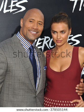 """LOS ANGELES, CA - JULY 23, 2014: Dwayne Johnson & Irina Shayk at the premiere of their movie  """"Hercules"""" at the TCL Chinese Theatre, Hollywood. - stock photo"""