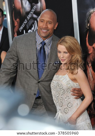 """LOS ANGELES, CA - JULY 23, 2014: Dwayne """"The Rock"""" Johnson & Kylie Minogue at the premiere of his movie """"Hercules"""" at the TCL Chinese Theatre, Hollywood. - stock photo"""