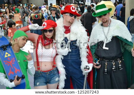 LOS ANGELES, CA - JULY 1: Fans in costume at an LA Anime Expo 2012 - Convention Center on july 1, 2012 in Los Angeles, CA
