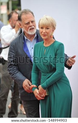 "LOS ANGELES, CA - JULY 11, 2013: Helen Mirren & husband Taylor Hackford at the Los Angeles premiere of her new movie ""Red 2"" at the Westwood Village Theatre."