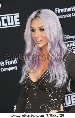 "LOS ANGELES, CA - JULY 15, 2014: Pop star Kesha at the world premiere of Disney's ""Planes: Fire & Rescue"" at the El Capitan Theatre, Hollywood."