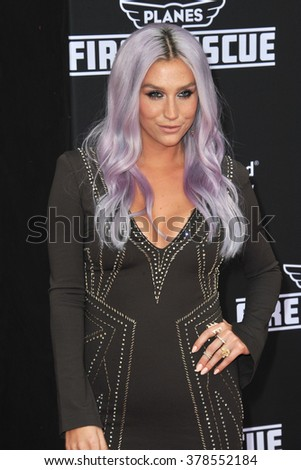"LOS ANGELES, CA - JULY 15, 2014: Pop star Kesha at the world premiere of Disney's ""Planes: Fire & Rescue"" at the El Capitan Theatre, Hollywood. - stock photo"