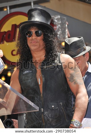 LOS ANGELES, CA - JULY 10, 2012: Rock guitarist Slash on Hollywood Blvd where he was honored with a star on the Hollywood Walk of Fame. - stock photo