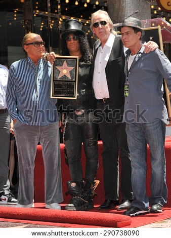 LOS ANGELES, CA - JULY 10, 2012: Rock guitarist Slash with Robert Evans, Jim Ladd & Charlie Sheen on Hollywood Blvd where he was honored with a star on the Hollywood Walk of Fame. - stock photo
