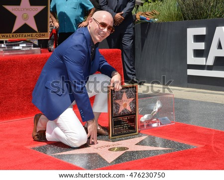 LOS ANGELES, CA. July 15, 2016: Singer Pitbull (Armando Christian Perez) on Hollywood Blvd where he was honored with the 2,584th star on the Hollywood Walk of Fame.