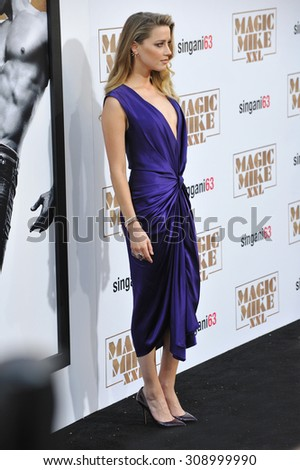 """LOS ANGELES, CA - JUNE 25, 2015: Actress Amber Heard at the world premiere of her movie """"Magic Mike XXL"""" at the TCL Chinese Theatre, Hollywood.  - stock photo"""