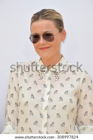 "LOS ANGELES, CA - JUNE 27, 2015: Actress Kathleen Robertson at the Los Angeles premiere of ""Minions"" at the Shrine Auditorium.  - stock photo"