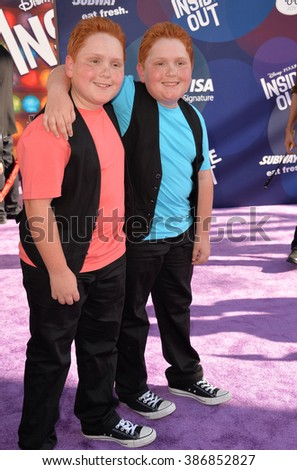 "LOS ANGELES, CA - JUNE 9, 2015: Benjamin Royer & Matthew Royer at the Los Angeles premiere of Disney-Pixar's ""Inside Out"" at the El Capitan Theatre, Hollywood."
