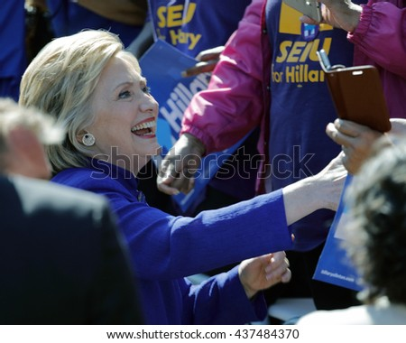 LOS ANGELES, CA - JUNE 6, 2016 - Democratic presidential candidate Hillary Clinton greets supporters at Get Out The Vote rally in Leimert Park Village Plaza a day before the California Primary - stock photo