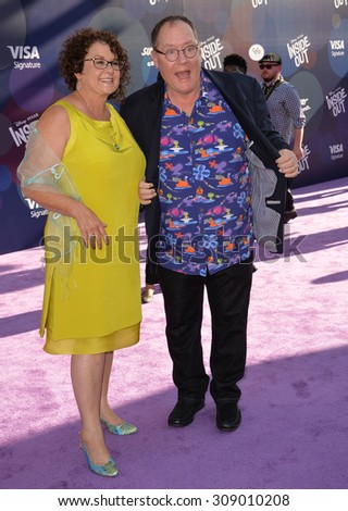 "LOS ANGELES, CA - JUNE 9, 2015: Disney-Pixar boss John Lasseter & wife Nancy at the Los Angeles premiere of his movie Disney-Pixar's ""Inside Out"" at the El Capitan Theatre, Hollywood.  - stock photo"