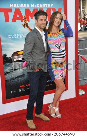 "LOS ANGELES, CA - JUNE 30, 2014: Eva Amurri Martino & husband Kyle Martino at the premiere of ""Tammy"" at the TCL Chinese Theatre, Hollywood.  - stock photo"