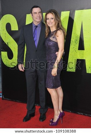 "LOS ANGELES, CA - JUNE 26, 2012: John Travolta & wife Kelly Preston at the world premiere of his movie ""Savages"" at Man Village Theatre, Westwood."
